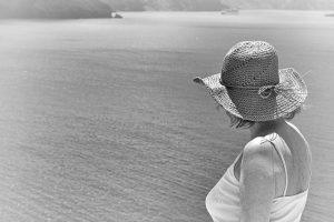 Lady in Santorini's hills, looking at the caldera