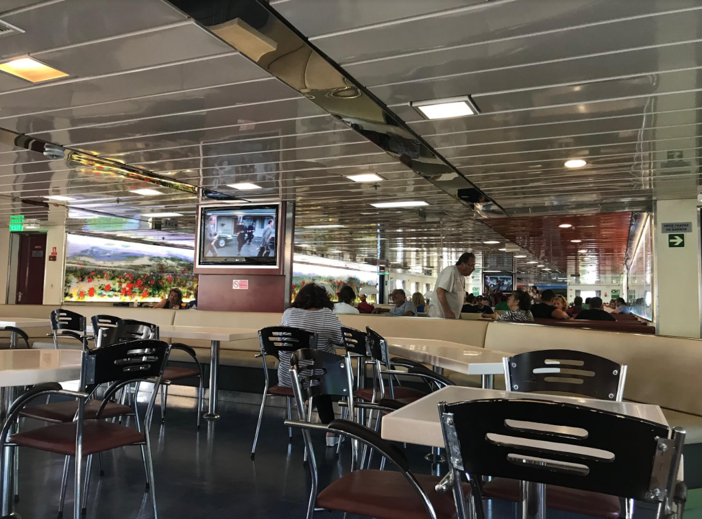 Inside the Panorama ferry. It has air-condition, a cafeteria and there is also an open deck if you want to sit outside and enjoy the sea and the sun.