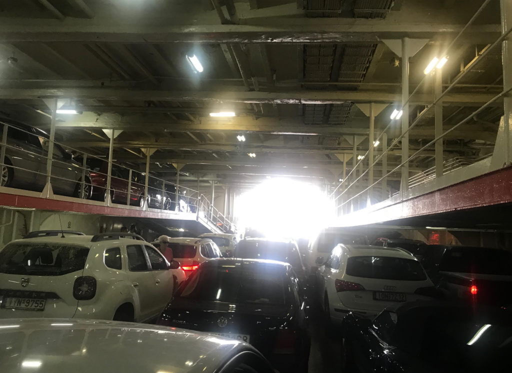 Inside the garage of the ferry. Once you arrive at the boat, only the drivers are allowed to enter the garage, and all the rest of the family has to get down from the car and enter through the passengers entry.