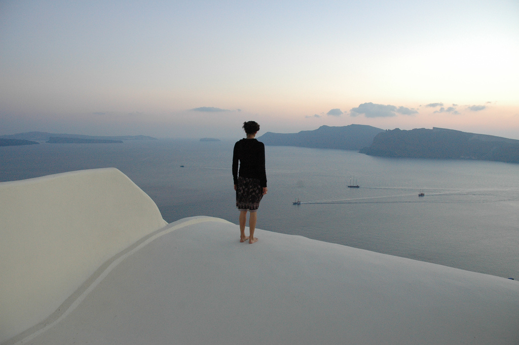 Lady looking over Santorini to the volcano